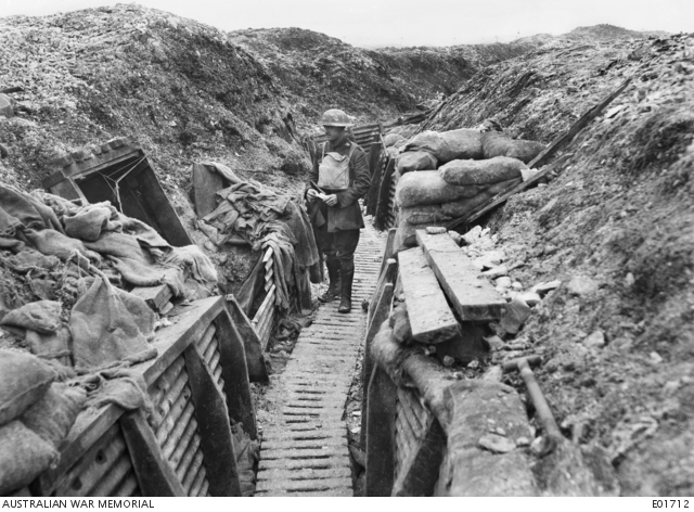 Captain Morris standing in a trench near tunnel entrance