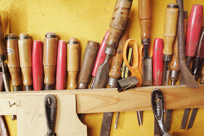 Various hand tools mounted on wall