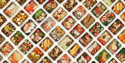 Many foil containers containing different meals
