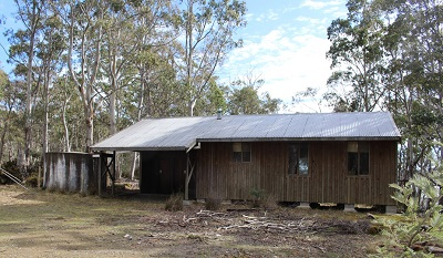 A timber shack in bush setting