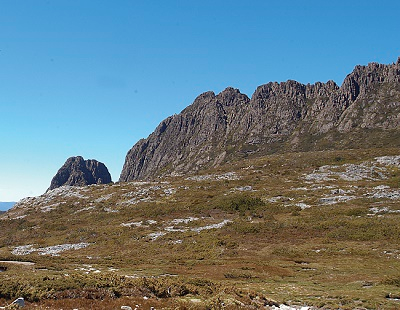 wilderness setting with mountain range in background