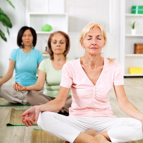 women meditating indoors
