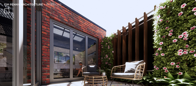 external paved patio with casual outdoor seats and ottoman in front of a small garden area
